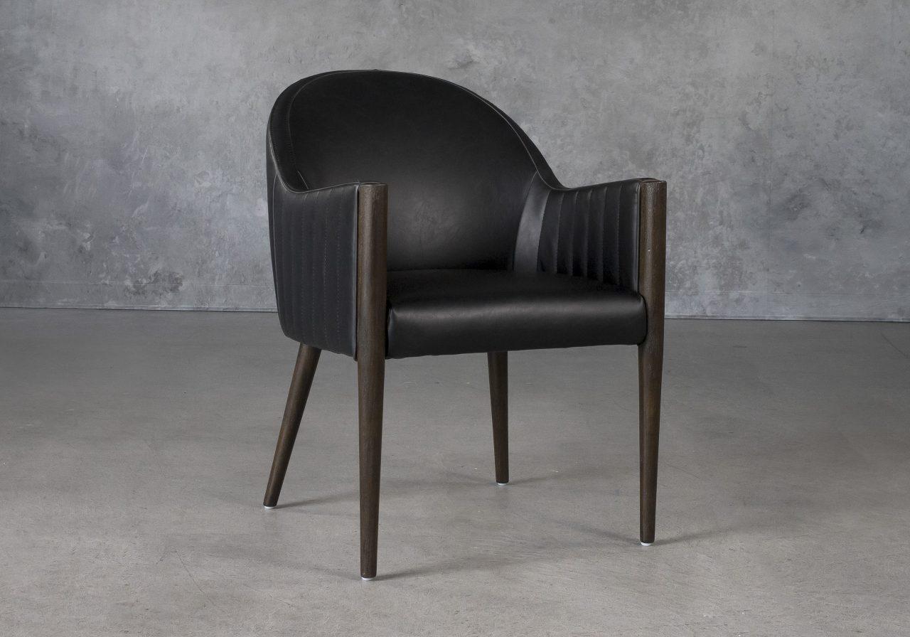 Raymond Dining Chair in Black CU Vinyl with Nutmeg Legs, Angle