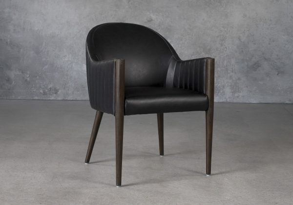 Raymond Dining Chair in Black CU Vinyl with Nutmeg Legs, Angle